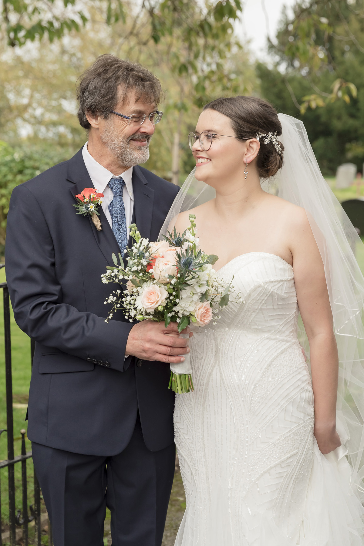 Wedding photo of Bride with her farther just before the wedding service