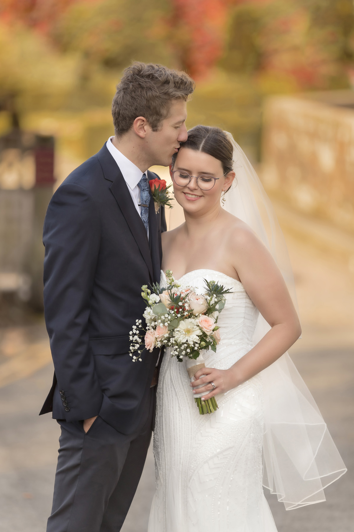Bride and Grooms bright and colourful autumnal wedding portrait at Coombe abbey
