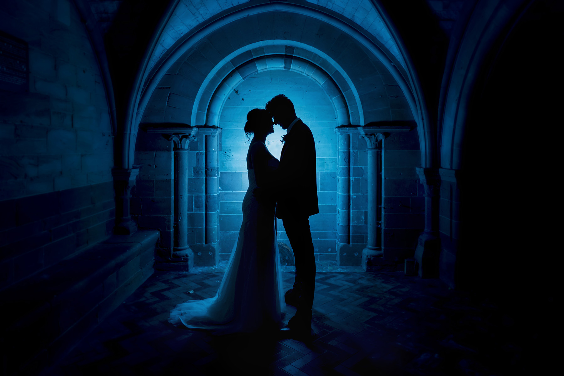Coombe abbey wedding photography; bride and groom night silhouette portrait in front of arch on their wedding day