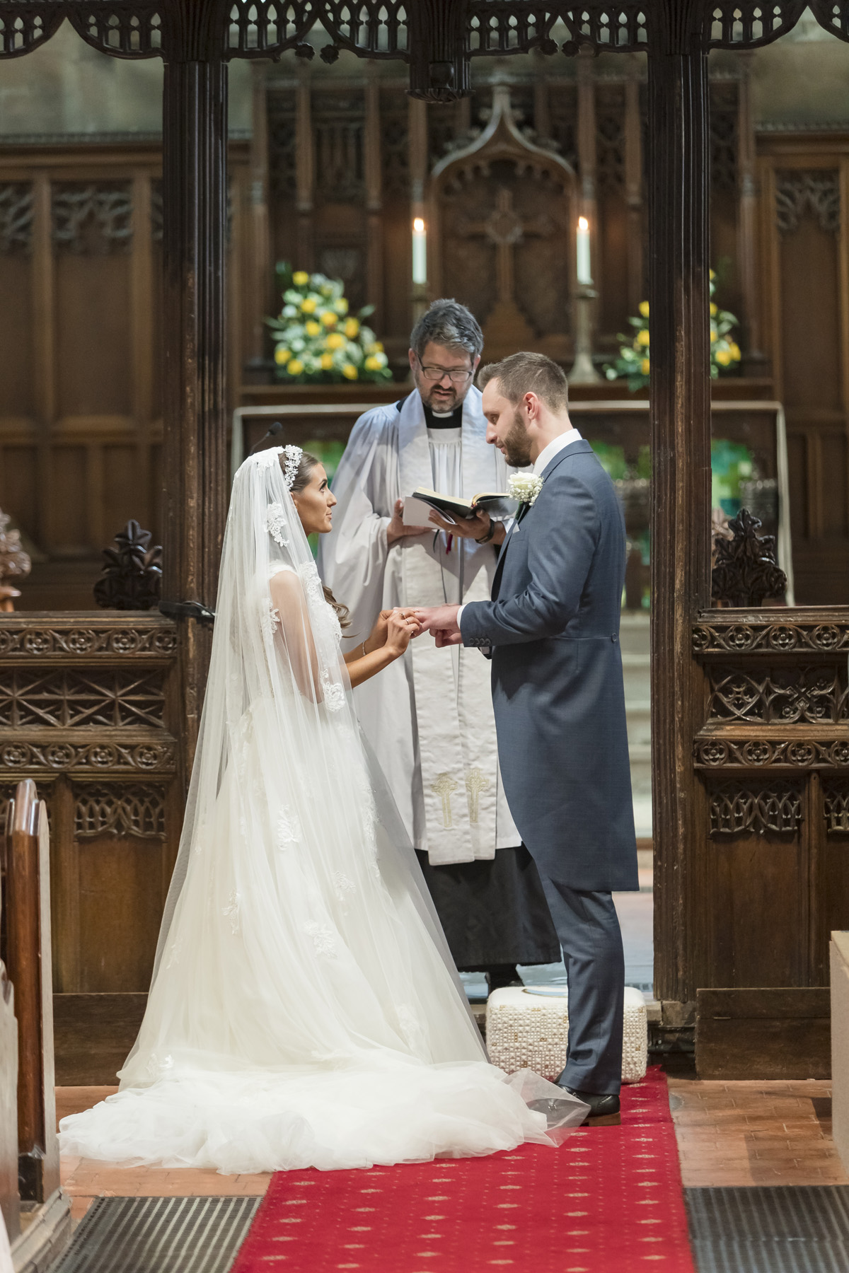 Bride and Groom exchanging vows at Knowle Church