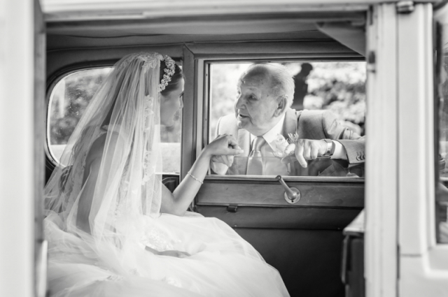 A quiet moment for the bride with her grandfather