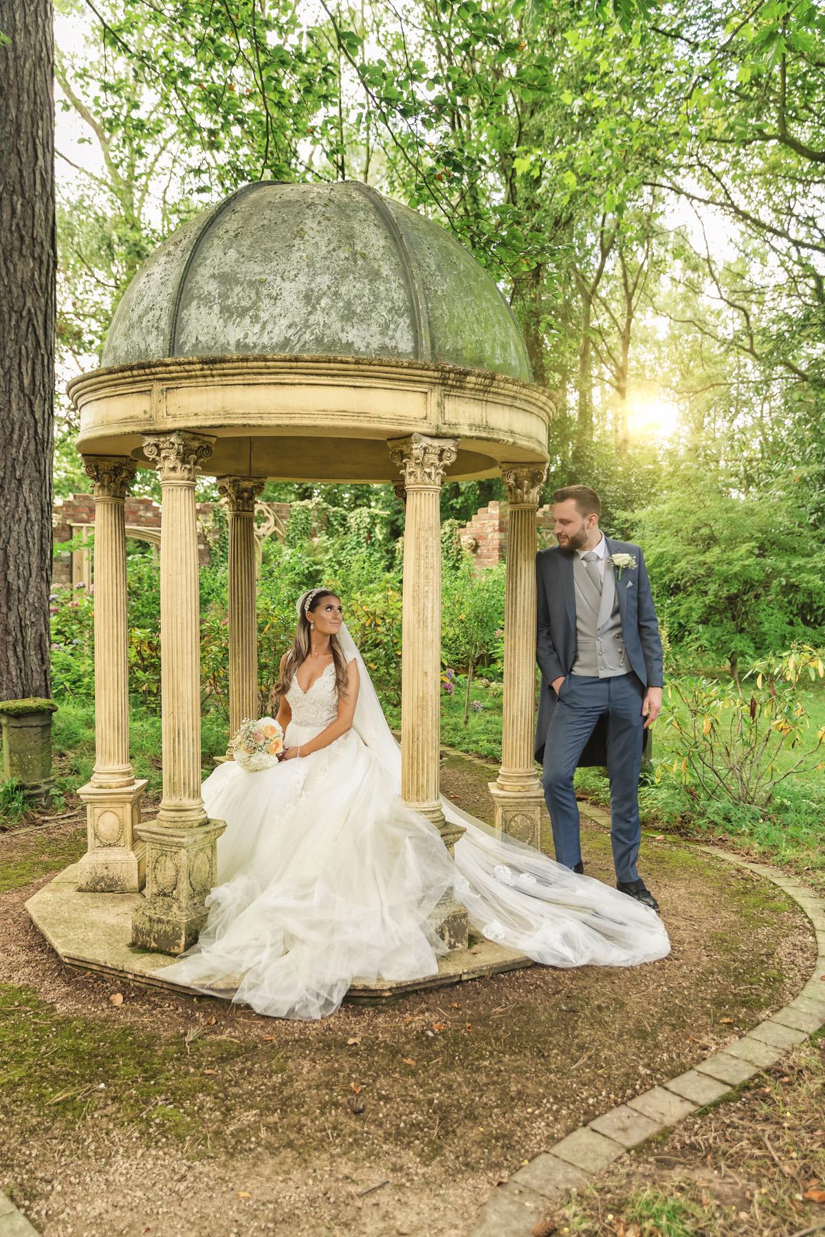 Moxhall wedding photography; Beautiful sunset photo of bride & groom under a stone domed gazebo