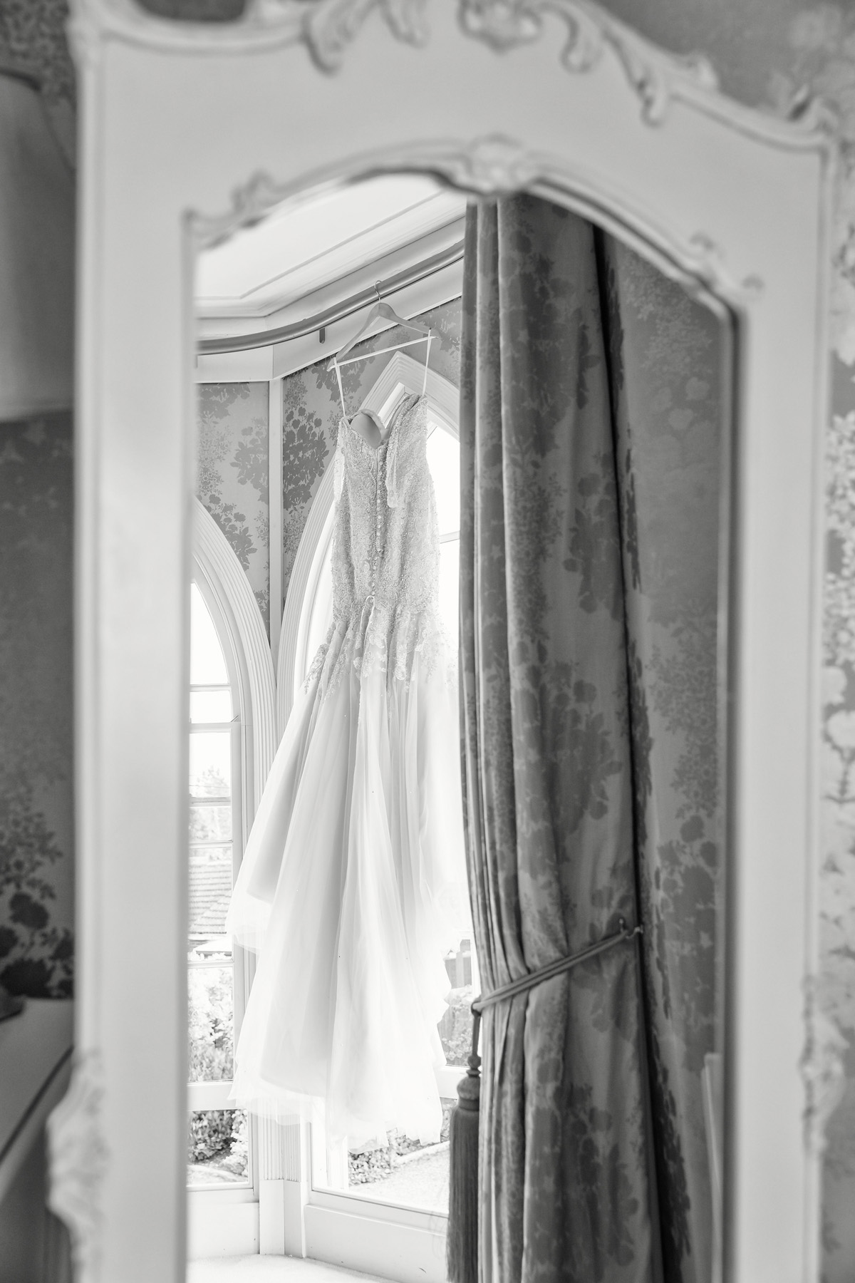 reflection of brides dress at Warwick house