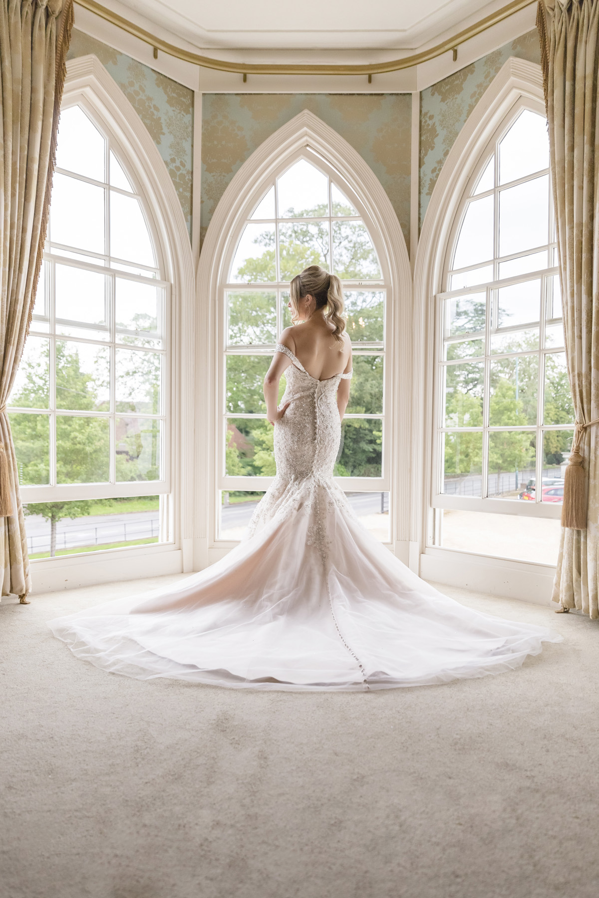 classic bridal portrait in front of arched windows at Warwick house