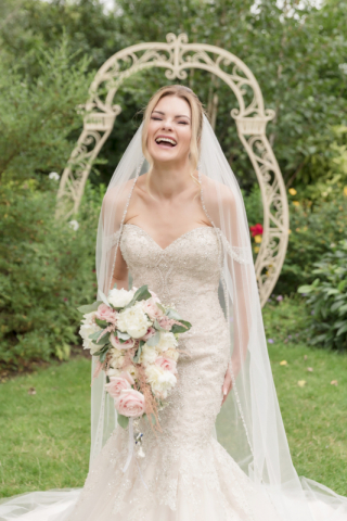 Bride portrait at Warwick house - Bride laughing