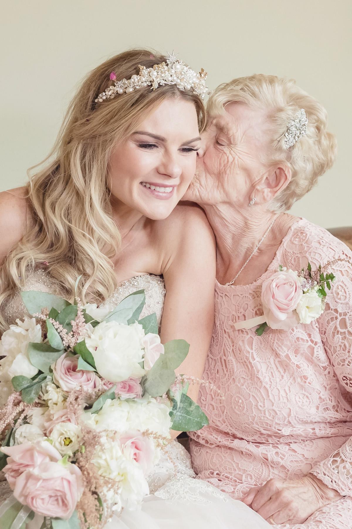 lovely moment between grandmas & bride