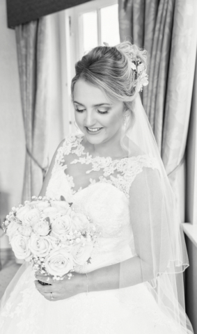 Beautiful black and white portrait of a bride in the bridal suite on their wedding day at The Ardencote hotel