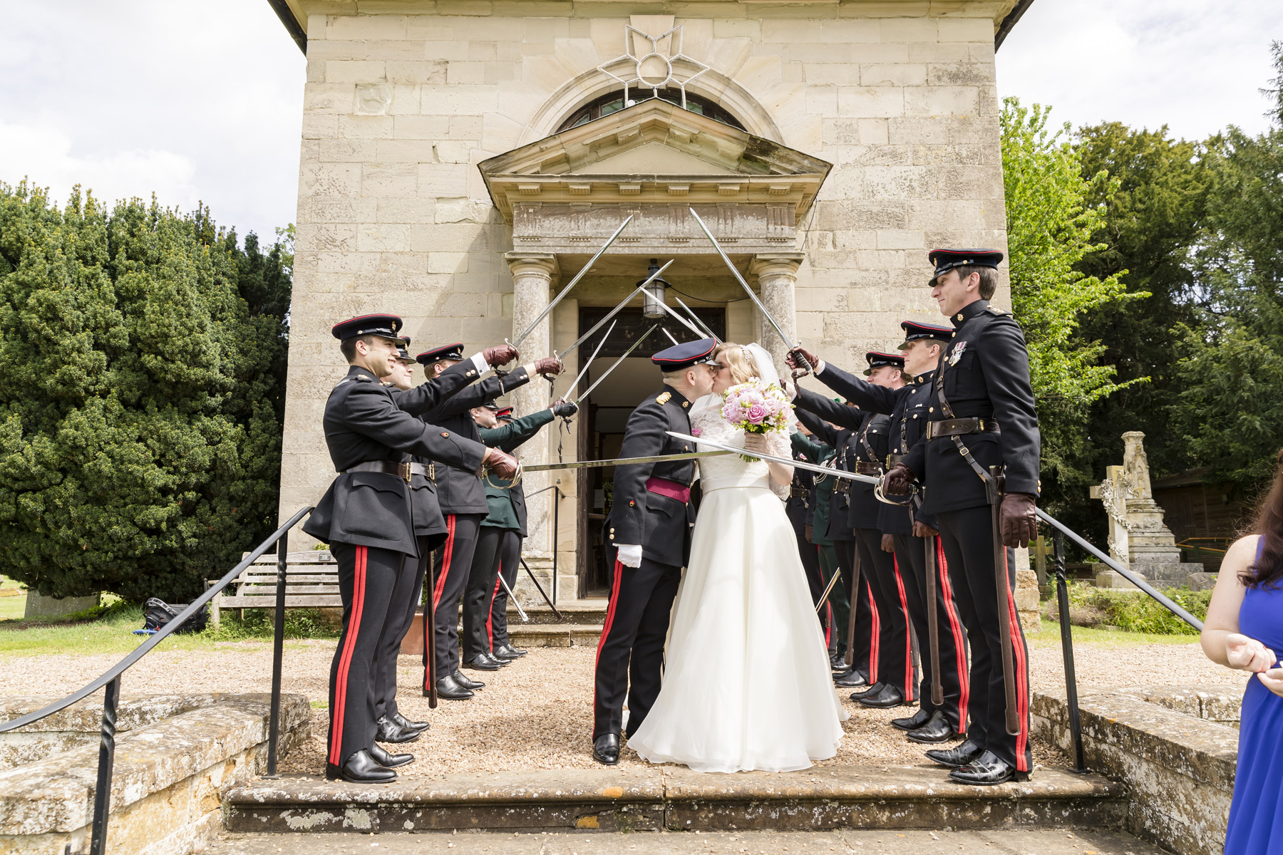 Traditional saber arch, saluting the newly weds at the Church at Walton Hall