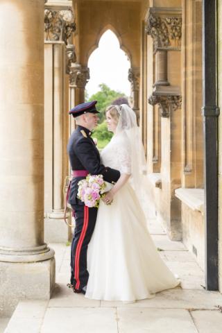 Bride & Groom in military uniform.  Portrait at Walton hall