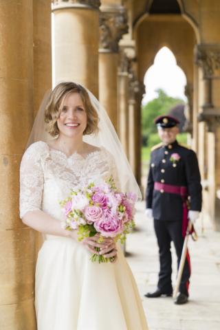 Bridal portrait with groom in military uniform at Walton Hall
