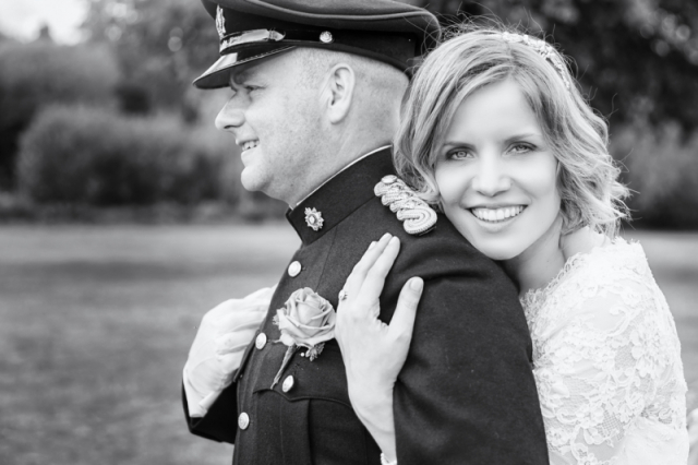Beautiful bride with Groom in military uniform. Black & White portrait taken at Walton hall