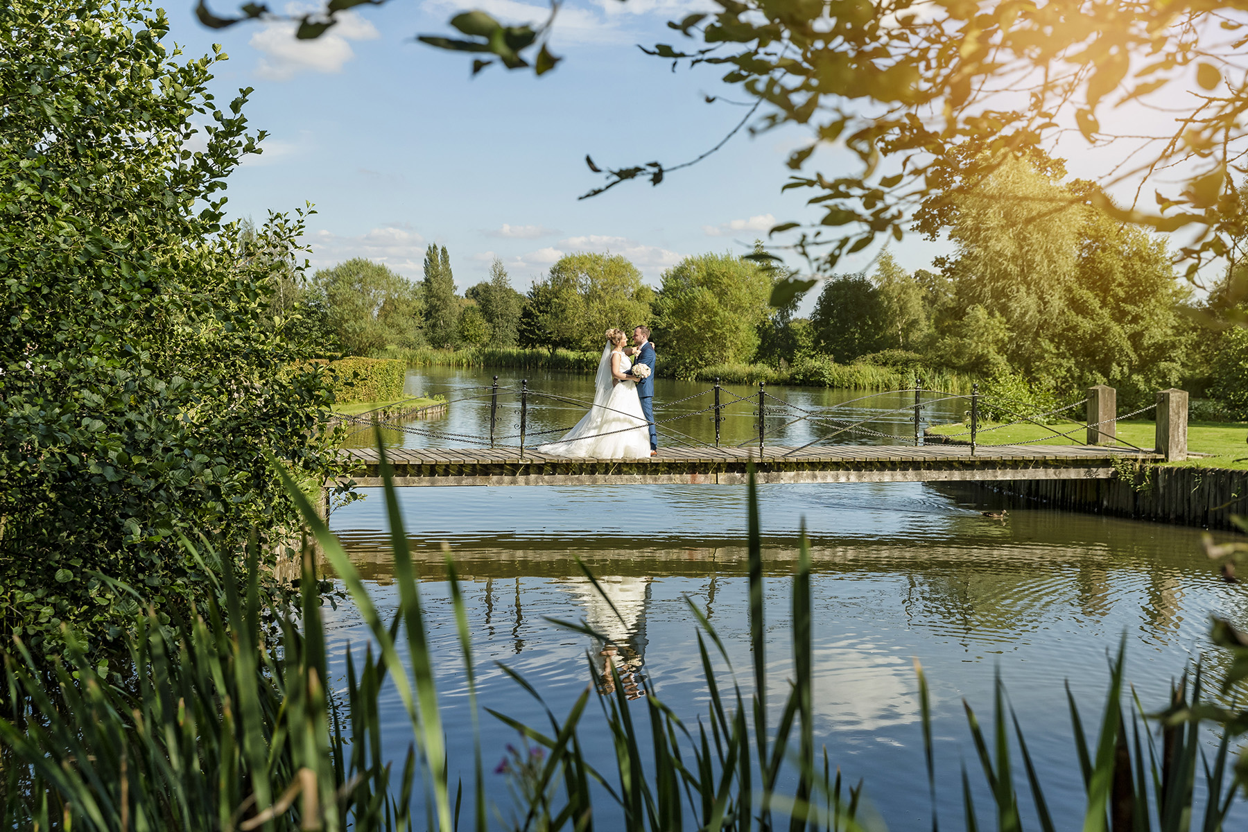 Bride and groom on the bride at Lakeside Ardencote Manor hotel warwickshire